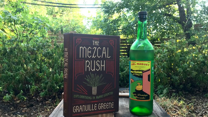 The Mezcal Rush book by Granville Greene and a bottle of Del Maguey