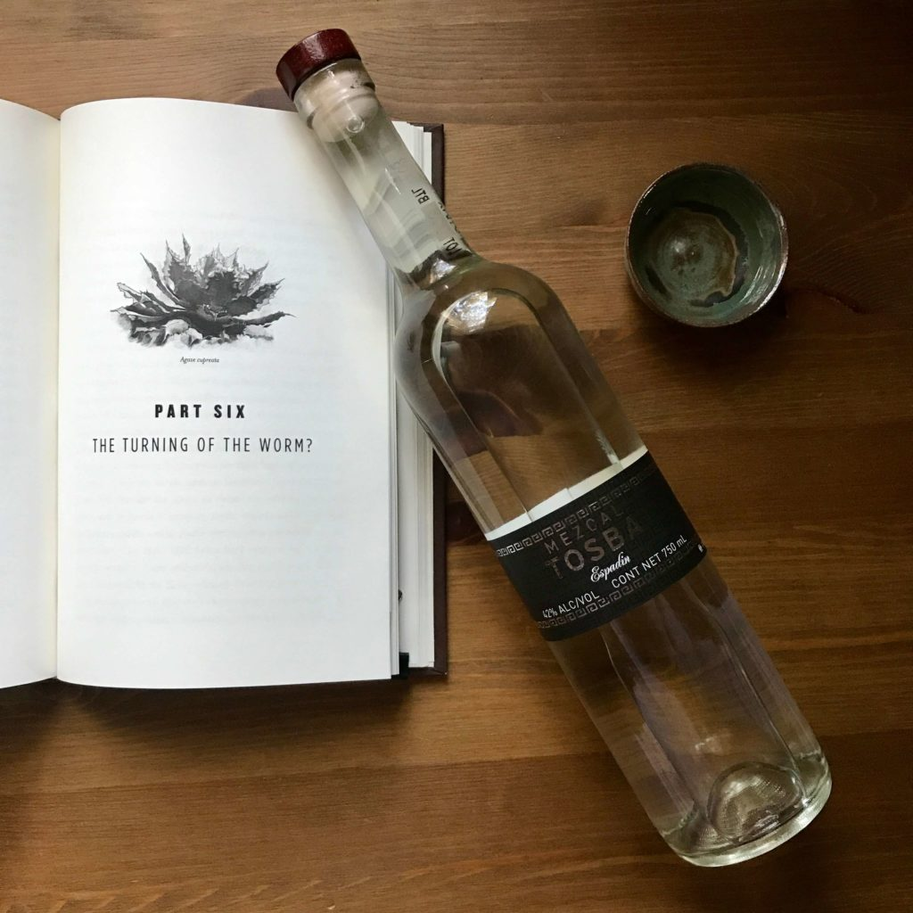 The Mezcal Rush book by Granville Green and a bottle of Tosba Espadin