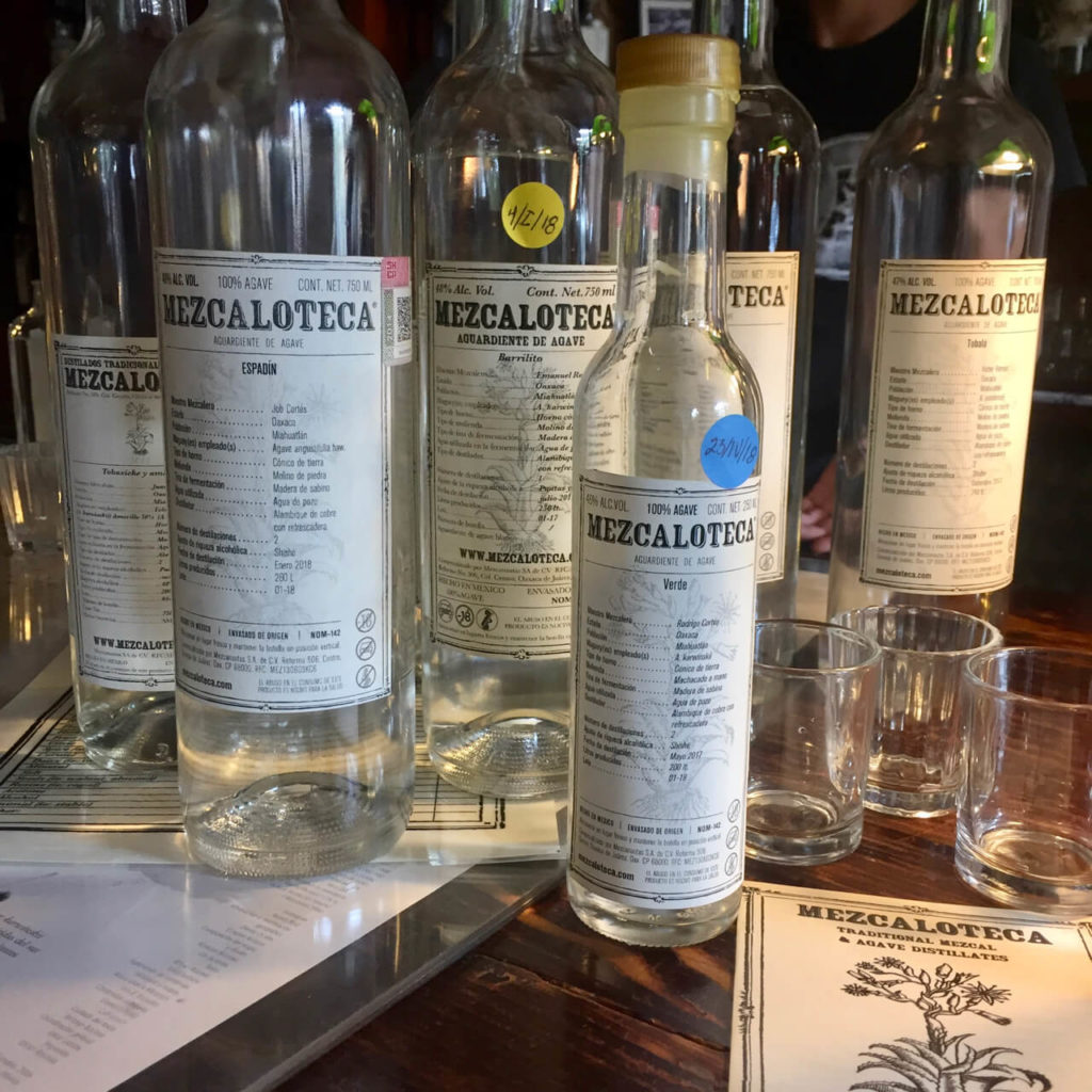 Bottles of different sizes at Mezcaloteca