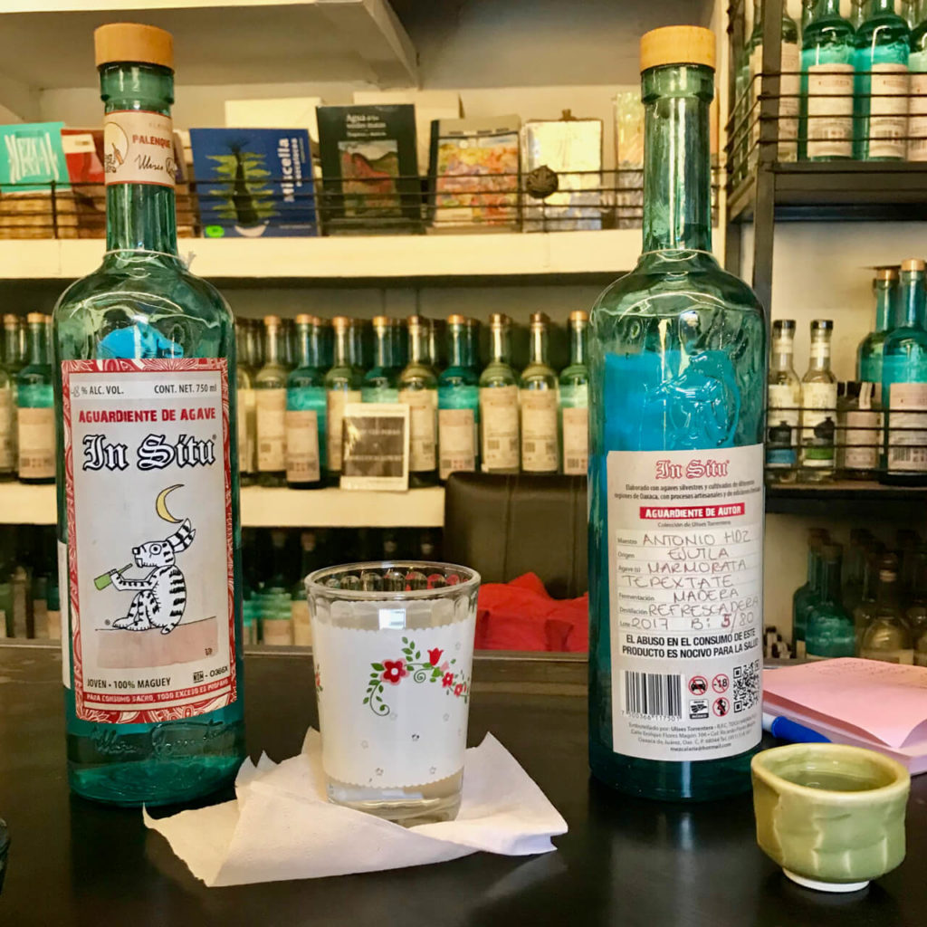 Two bottles on the bar at Mezcaleria In Situ
