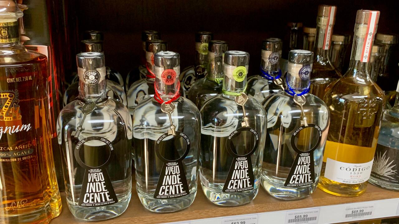 Viejo Indecente mezcal bottles at a liquor store