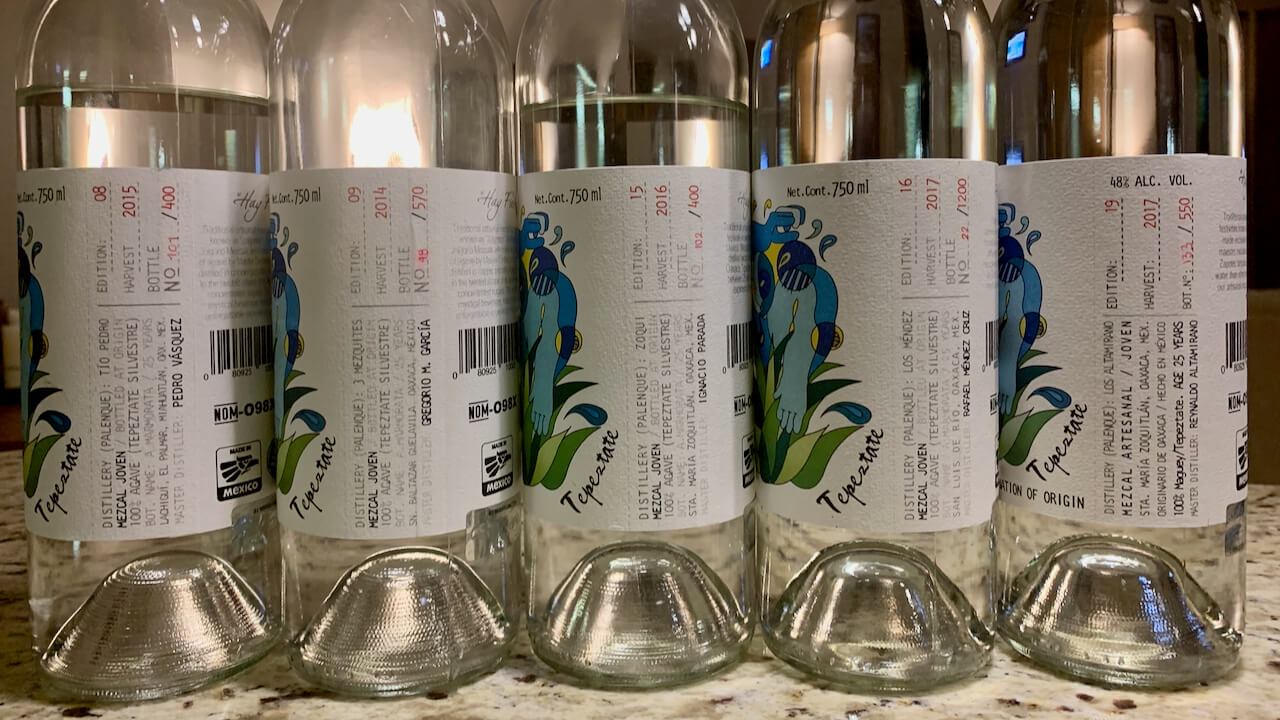 Five bottles of El Jolgorio Tepeztate mezcal from different mezcaleros