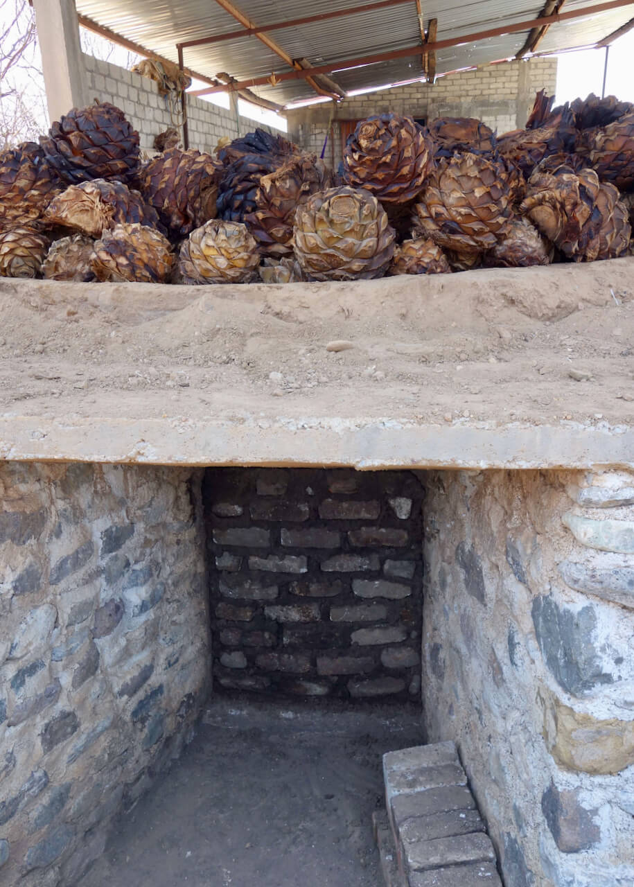 The underside of a mezcal cooking pit where firewood is placed